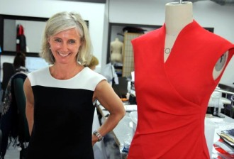 Czech born fashion designer Michaela Jedinak, alongside one of her dresses, still in the design stages, at her factory in North London